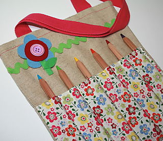 Flower brooch on tote bag