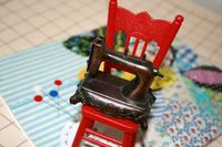 Mini machine on chair