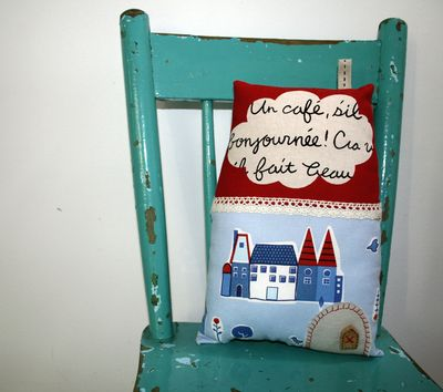 French house cushion on chair